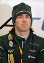 Charles Pic waits patiently in the Caterham garage