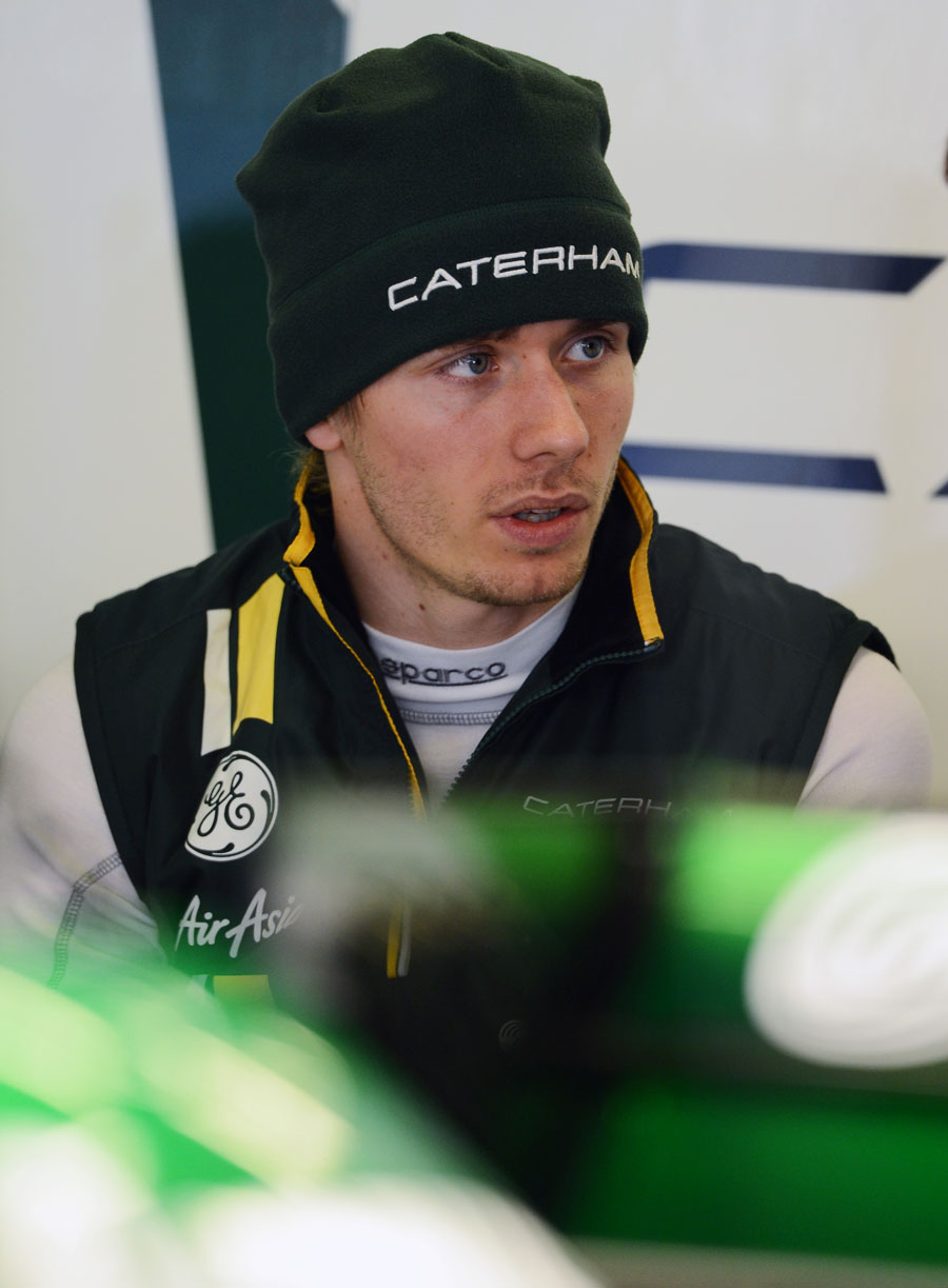 Charles Pic deep in conversation in the Caterham garage