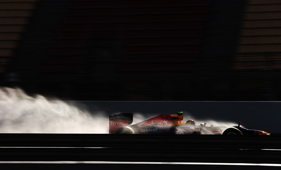 Mark Webber blasts through the spray in the RB9