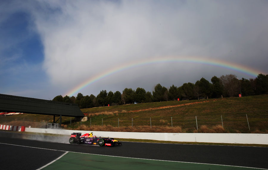 Mark Webber in the wet and with a rainbow