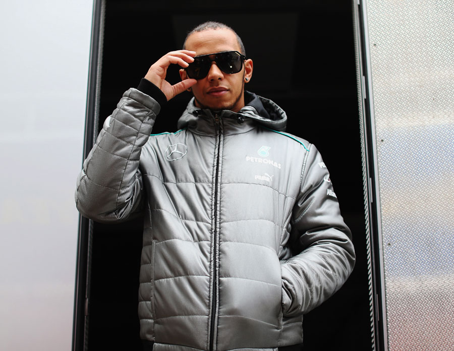 Lewis Hamilton poses for a photo outside the Mercedes motorhome