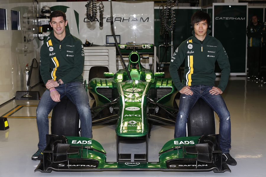 New Caterham reserve drivers Alexander Rossi and Ma Qing Hua pose with the CT03