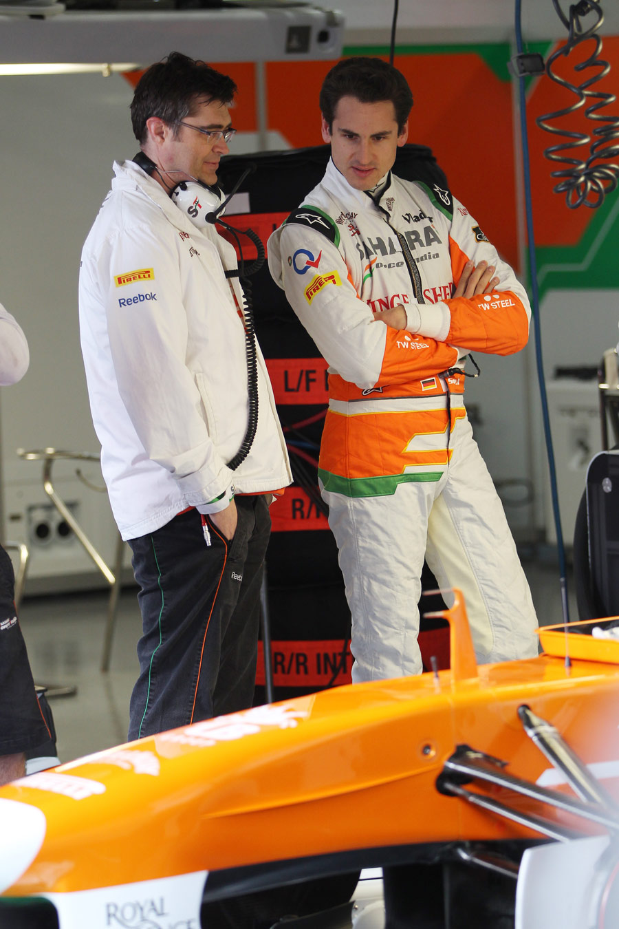 Adrian Sutil looks at the detail on the Force India