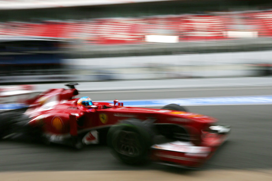 Fernando Alonso's Ferrari arrives in the pits