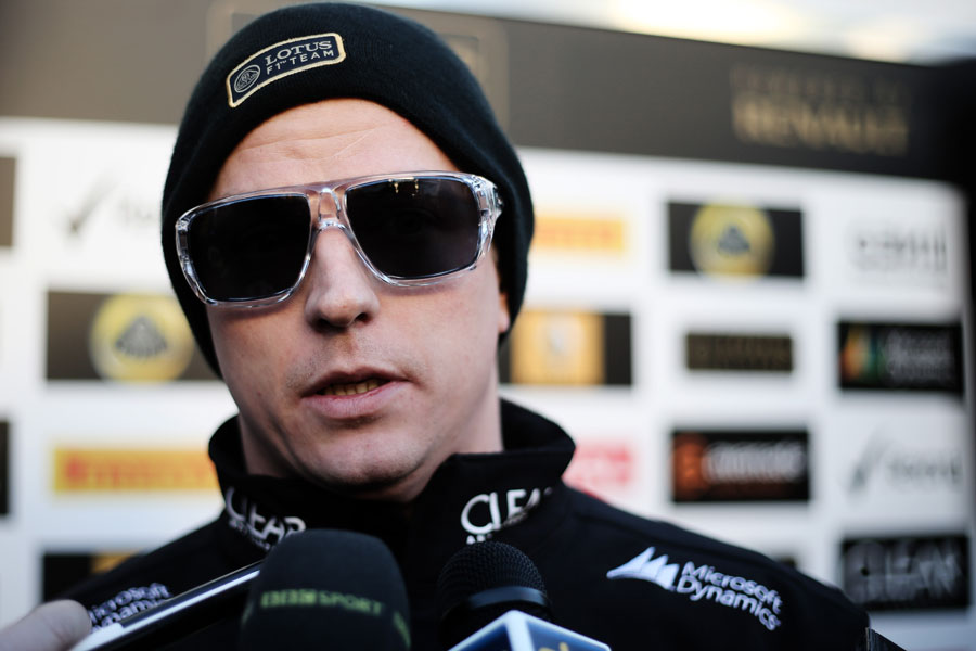 Kimi Raikkonen talks to the press