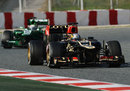 Davide Valsecchi on track in the Lotus ahead of Giedo van der Garde's Caterham