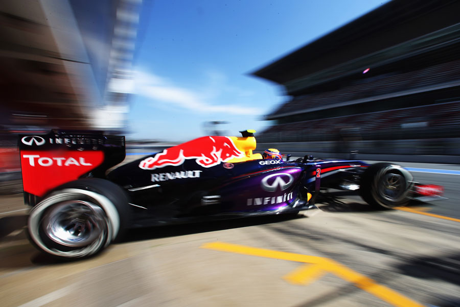Mark Webber leaves the Red Bull garage