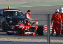 Felipe Massa's Ferrari minus a wheel after an upright failure