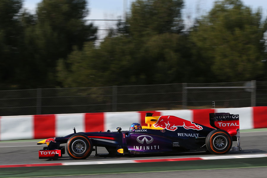 Sebastian Vettel on track in the Red Bull, complete with aero measuring devices at the rear