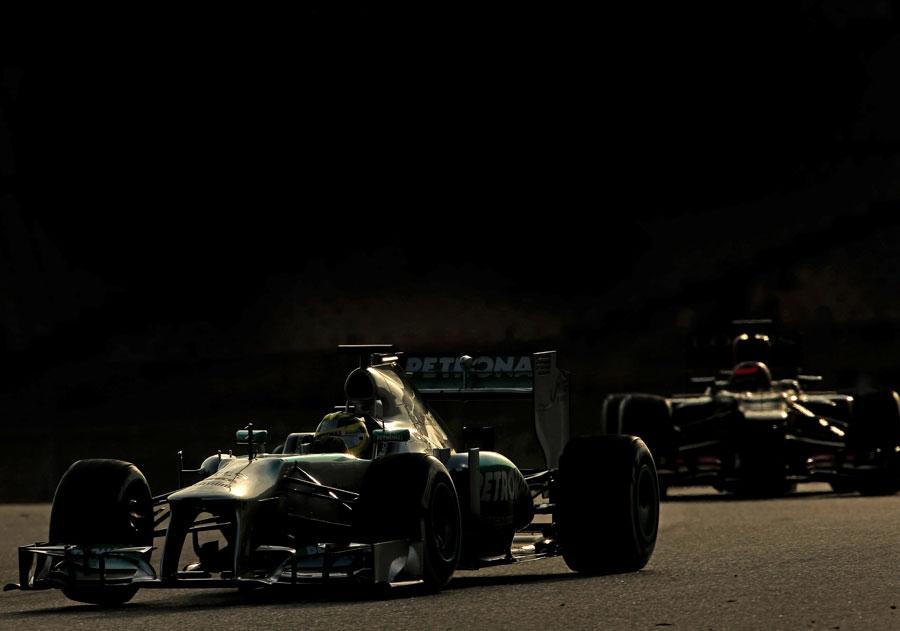 Nico Rosberg leads Kimi Raikkonen on track