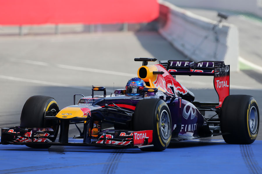 Sebastian Vettel returns to the Red Bull pits