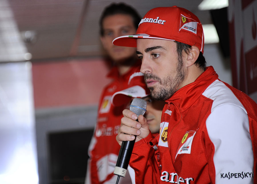 Fernando Alonso talks to the press at a media day