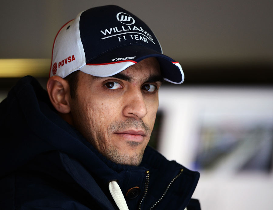 Pastor Maldonado watches on from the garage