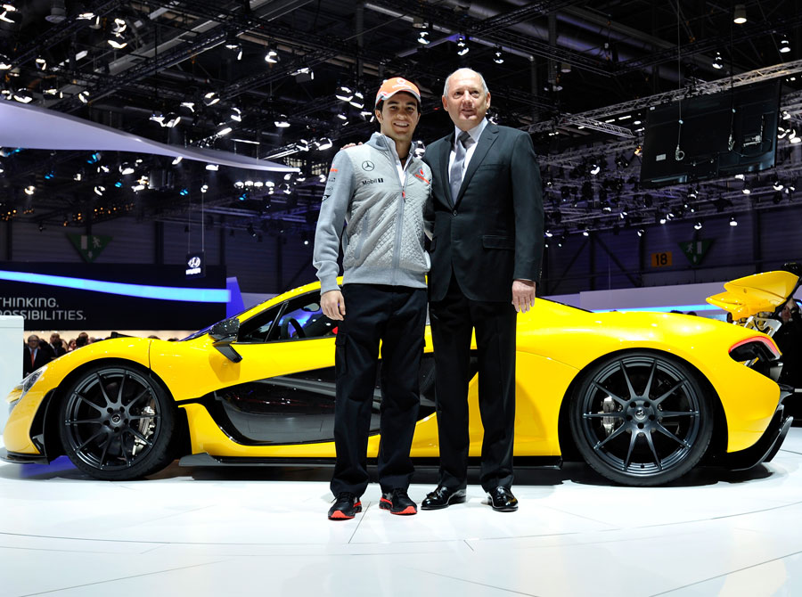 Sergio Perez and McLaren boss Ron Dennis pose with the new McLaren P1
