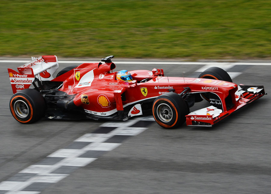 Fernando Alonso's crosses the finish line during testing