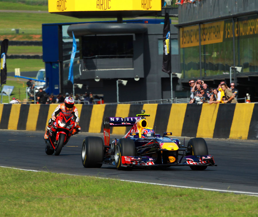 Mark Webber and Casey Stoner on track at Sydney Motorsport Park
