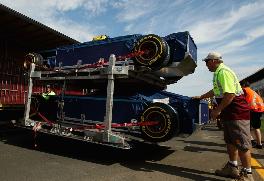 Tor Rosso cars are unloaded into the pit lane at Albert Park