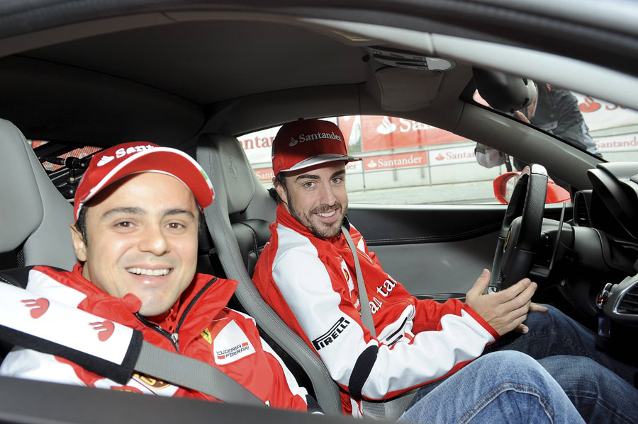 Fernando Alonso and Felipe Massa in a Ferrari 458 at a media day