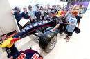 Mark Webber meets schoolchildren at an Infiniti dealership