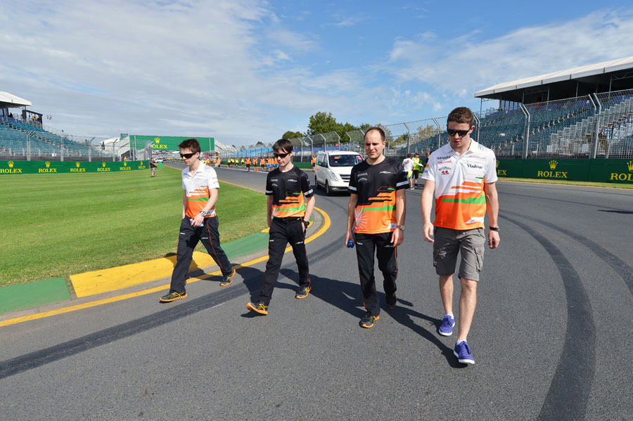 Paul di Resta walks the track with his Force India engineers