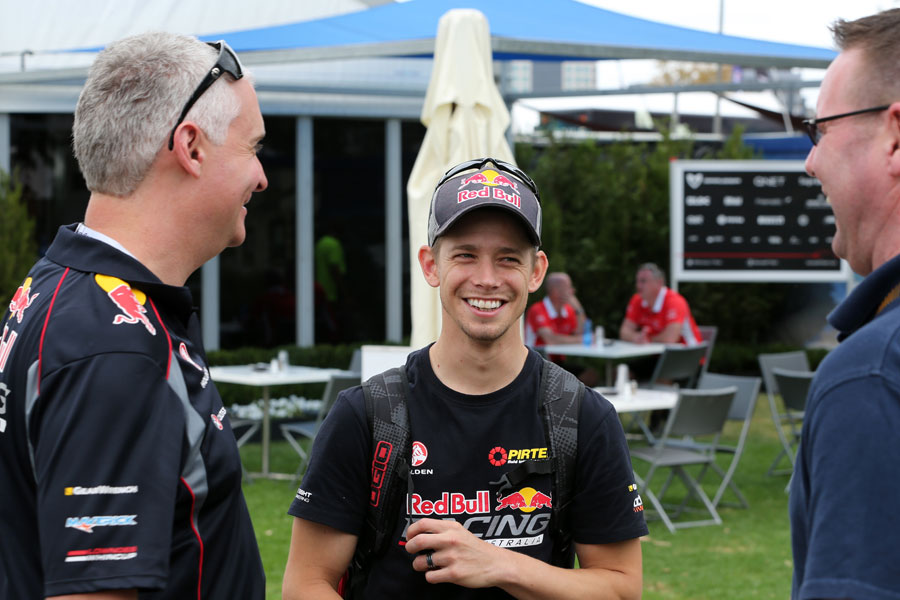 Casey Stoner enjoys a joke in the paddock on Wednesday