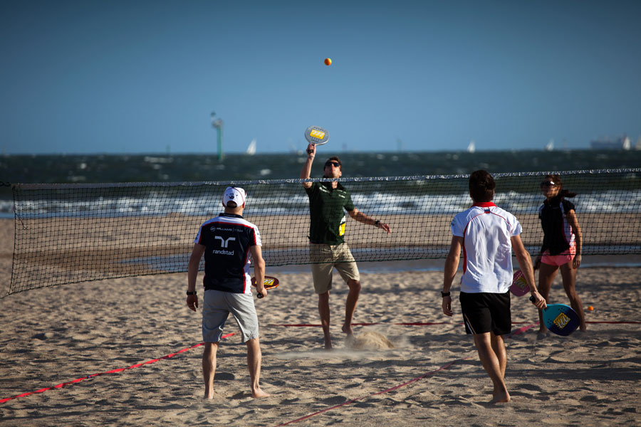 Giedo van der Garde plays beach tennis against Valtteri Bottas and Jules Bianchi