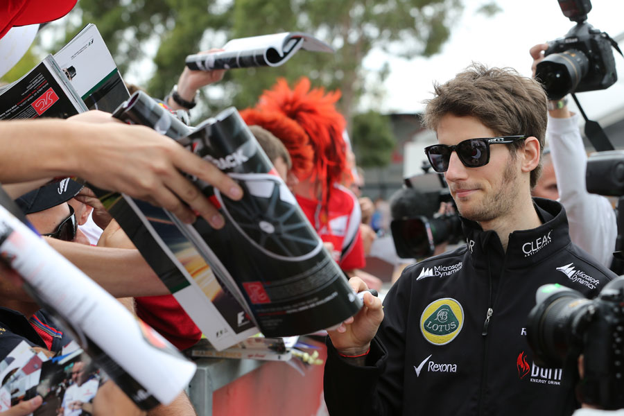 Romain Grosjean signs autographs