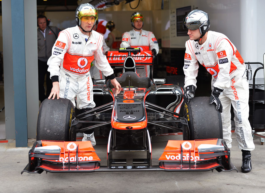Sergio Perez's McLaren is wheeled towards scrutineering