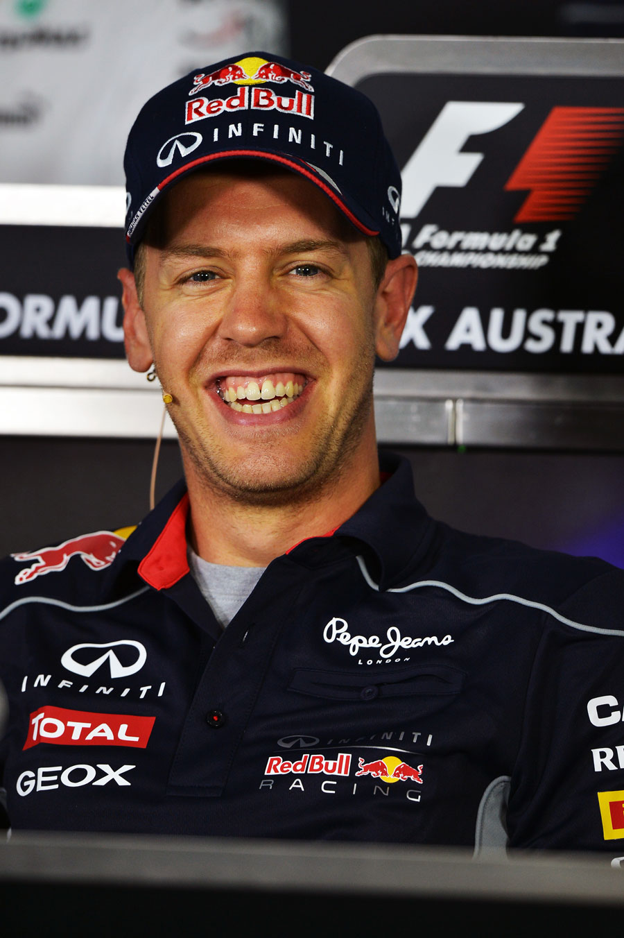 Sebastian Vettel enjoys a joke in the driver press conference
