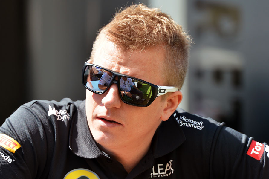 Kimi Raikkonen enjoys the Thursday sunshine