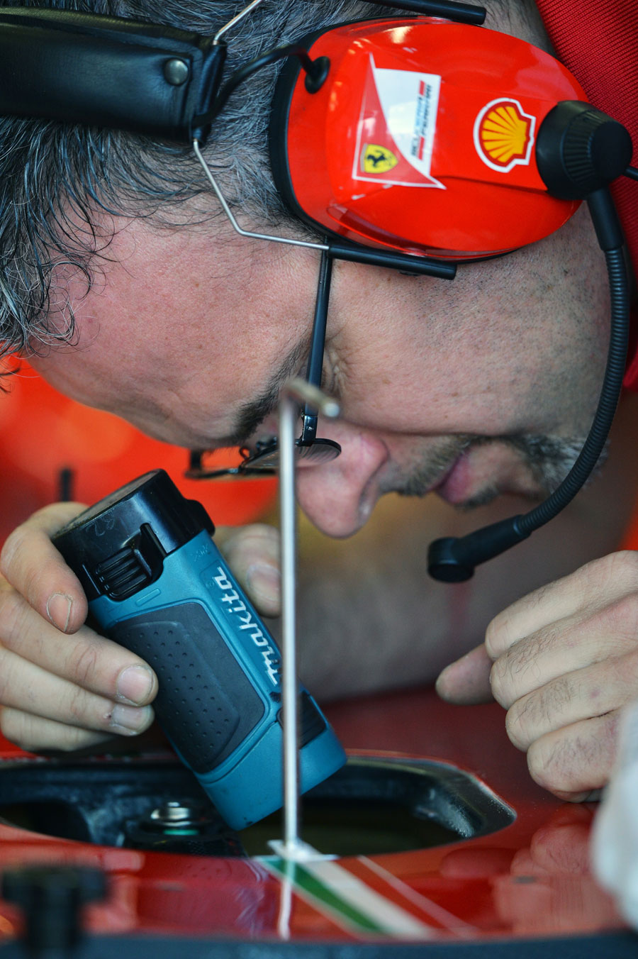 A Ferrari mechanic hard at work