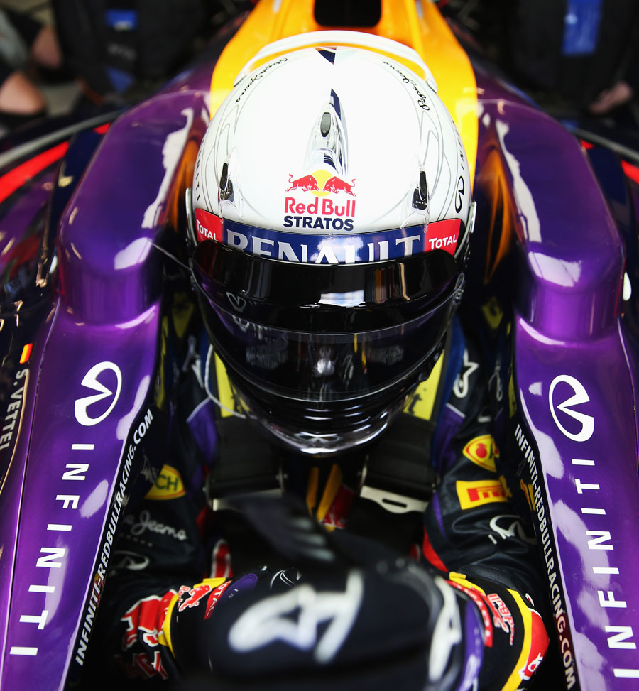Sebastian Vettel prepares to start the defence of his title