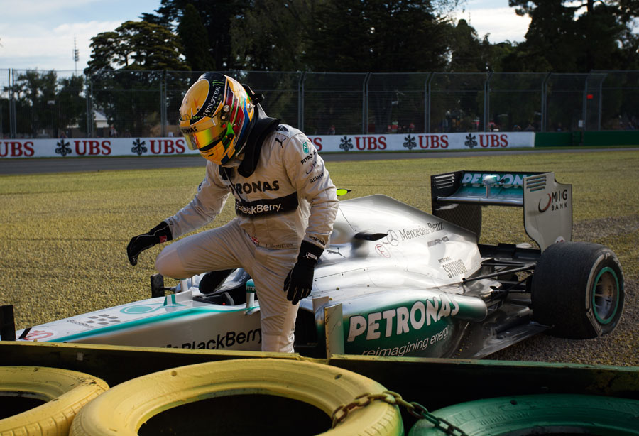 Lewis Hamilton climbs out of his Mercedes after running off at Turn 6