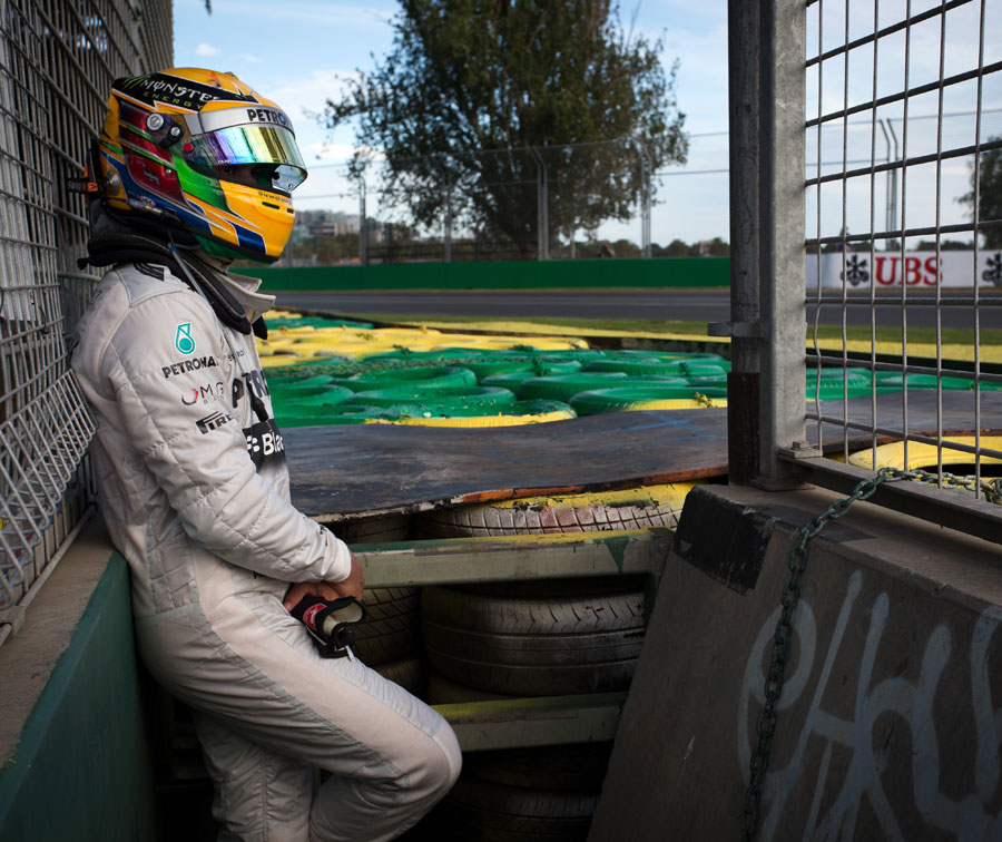 Lewis Hamilton waits for a lift after running off at Turn 6
