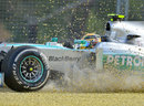 Lewis Hamilton's Mercedes ploughs through the gravel
