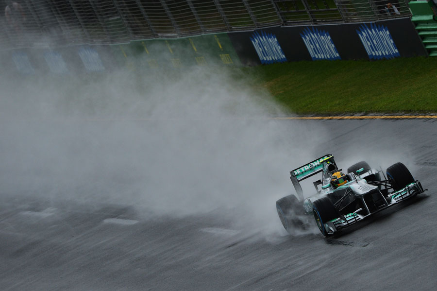 Lewis Hamilton cuts through the spray during a messy Q1