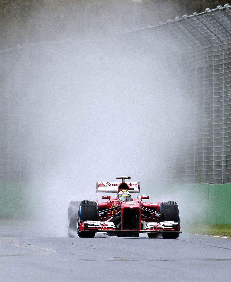 Felipe Massa throws up a wall of spray
