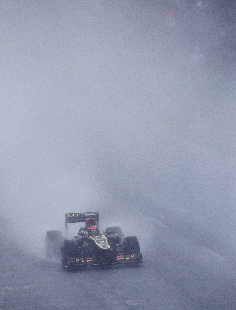 Kimi Raikkonen cuts through the gloom and the rain