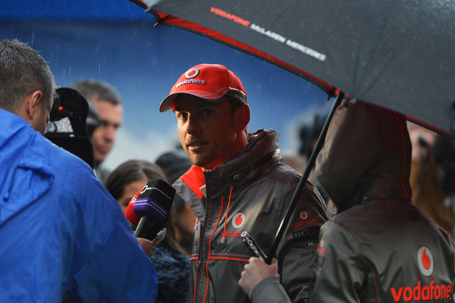 A soggy Jenson Button chats to the media