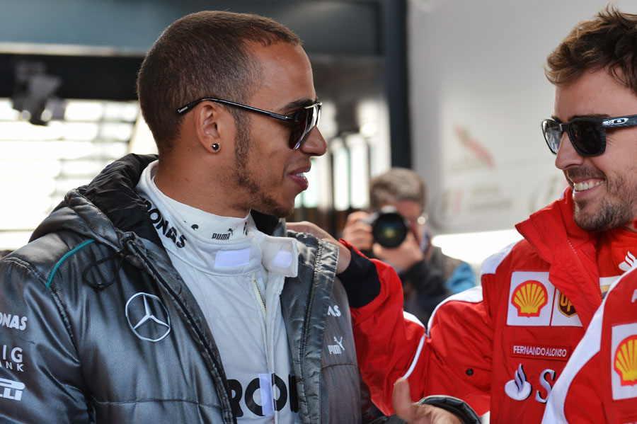 Lewis Hamilton and Fernando Alonso chat before the race