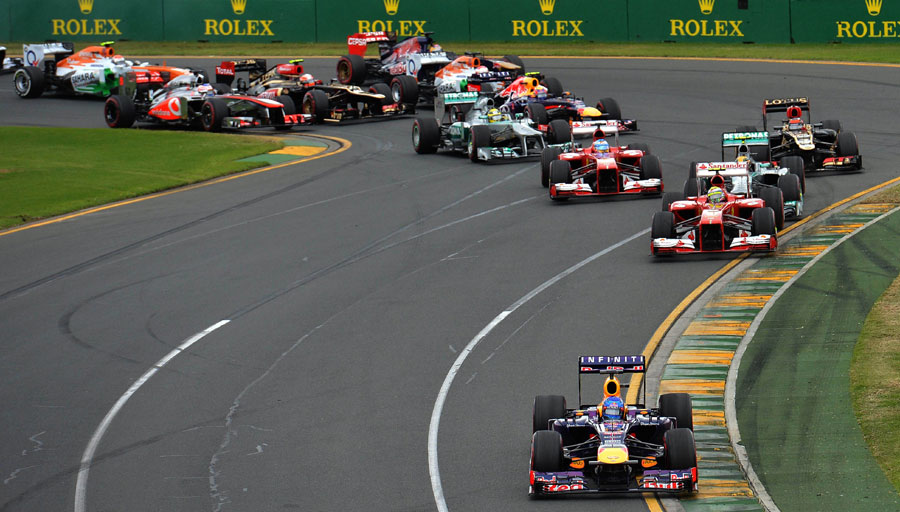 Sebastian Vettel leads the field away