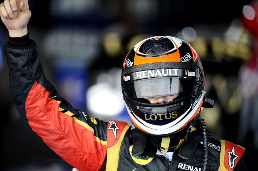 Kimi Raikkonen celebrates victory