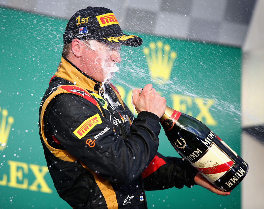 Kimi Raikkonen gets a soaking on the podium