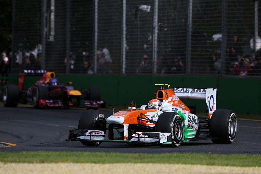 Adrian Sutil leads Sebastian Vettel