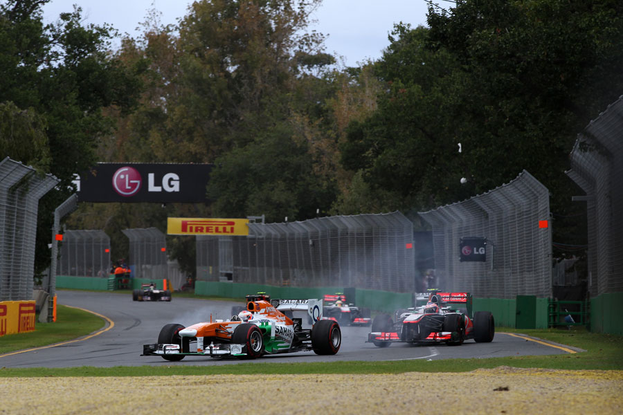 Paul di Resta locks up defending from Jenson Button