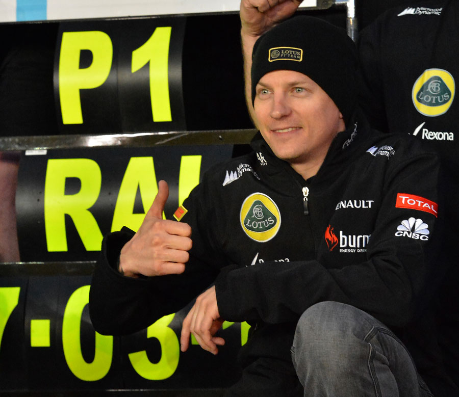 Kimi Raikkonen celebrates his victory with his team