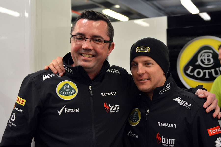 Kimi Raikkonen celebrates his victory with Eric Boullier