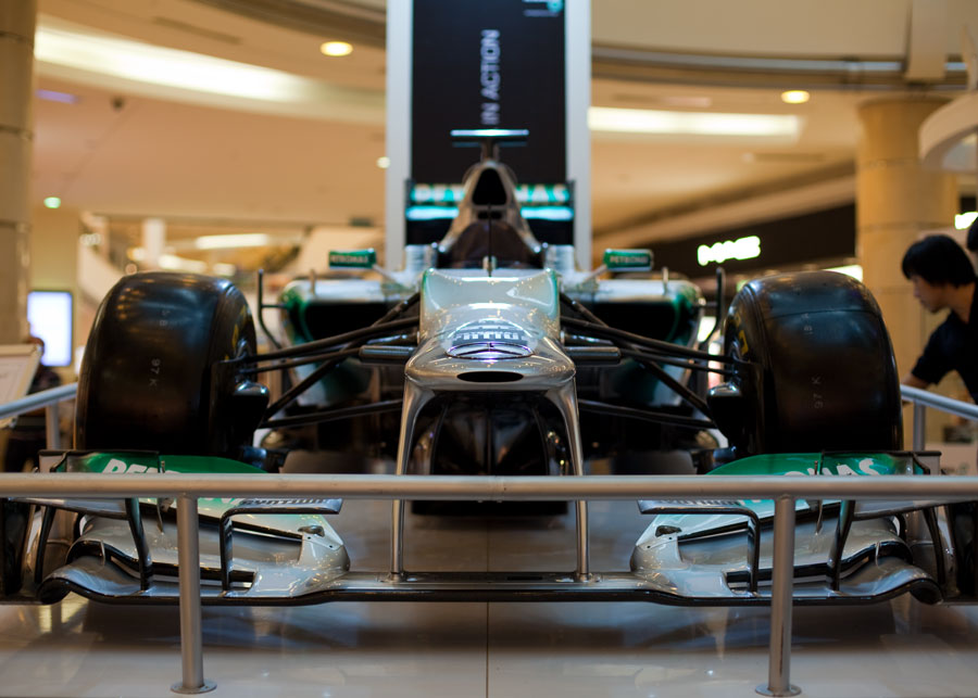 A Mercedes W03 on display in the shopping mall underneath the Petronas Twin Towers