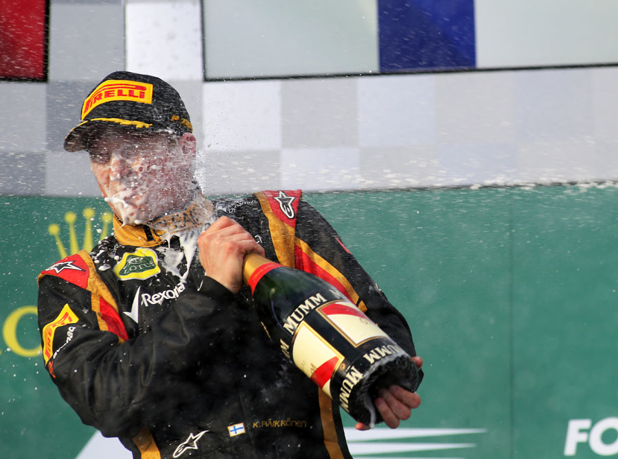 Kimi Raikkonen celebrates his victory in typical style
