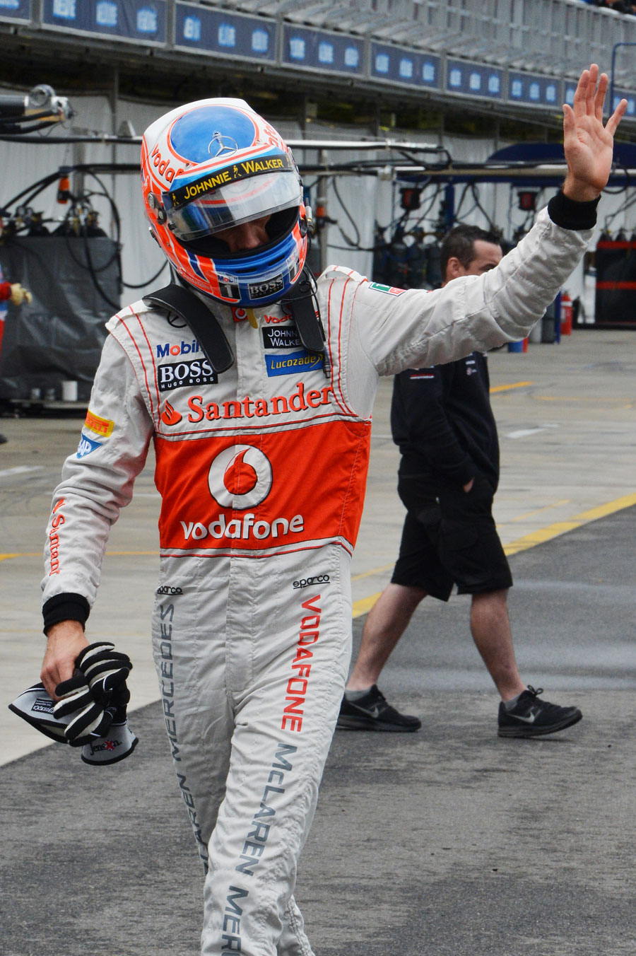 Jenson Button waves to the crowd after qualifying